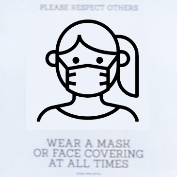 Details from a sign on the door at Quarter Horse Coffee in Birmingham, requesting that you wear a mask or face covering at all times.