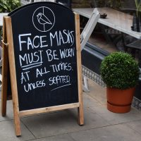The A-board outside Chalk Coffee is a sign of the times, reminding you that you need to wear a mask (from October 2020).