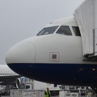 The nose of the British Airways Airbus A319 standing on the tarmac at Heathrow, waiting to take me to Manchester in March 2018.