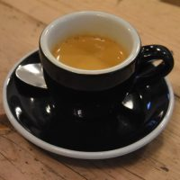 My espresso, served in a classic black cup, at Attendant Clerkenwell, made with the Brazilian Esmeralda house espresso.