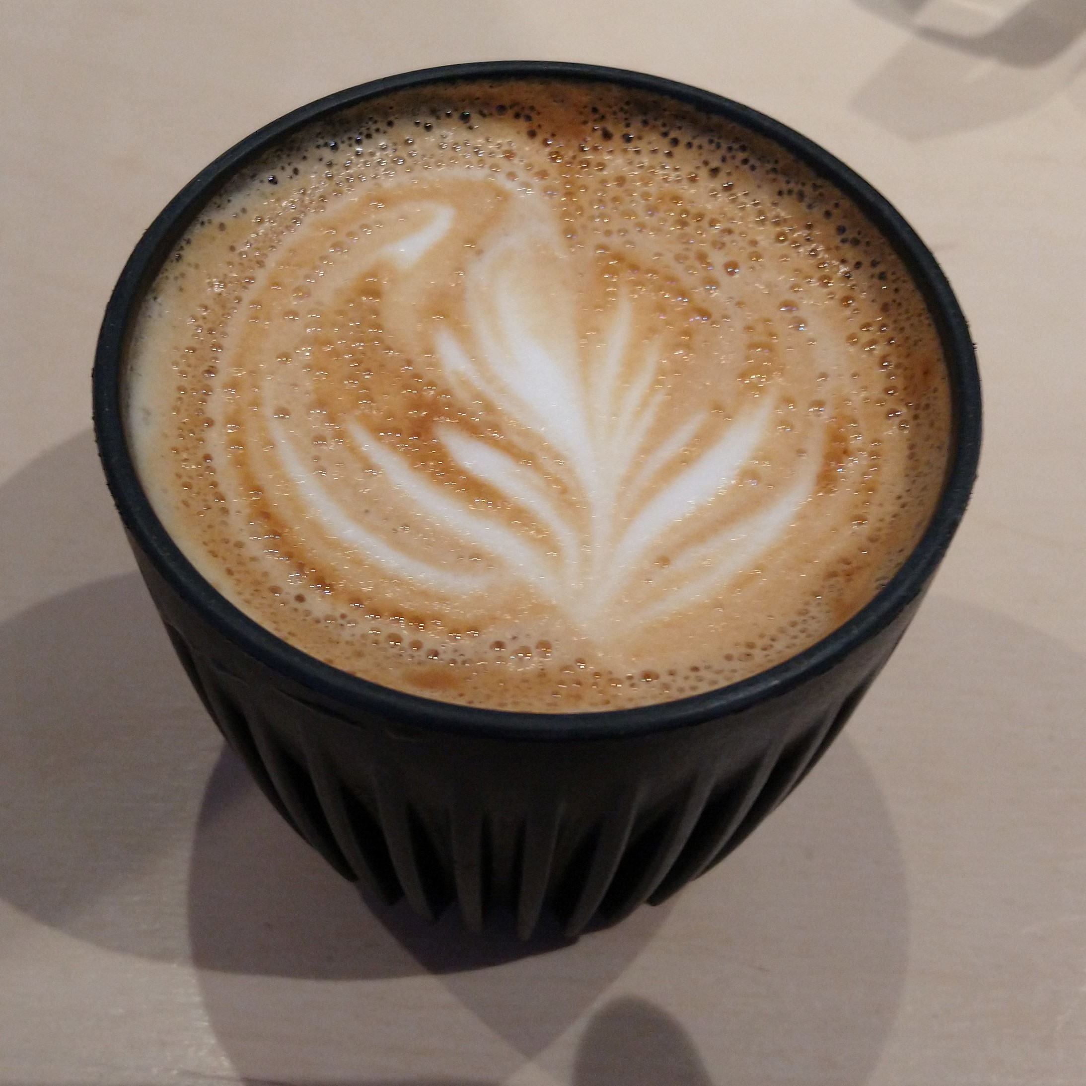 March 22nd, 2020, and the last flat white I was to have for several months, from Surrey Hills Coffee, served in my HuskeeCup.