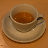 An Ethiopian Chelelektu, roasted and served as an espresso in a classic, white cup at Catalyst.