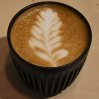 My flat white, made with the Surrey Hills Coffee Holmbury Hill blend and served in my HuskeeCup at Koja.