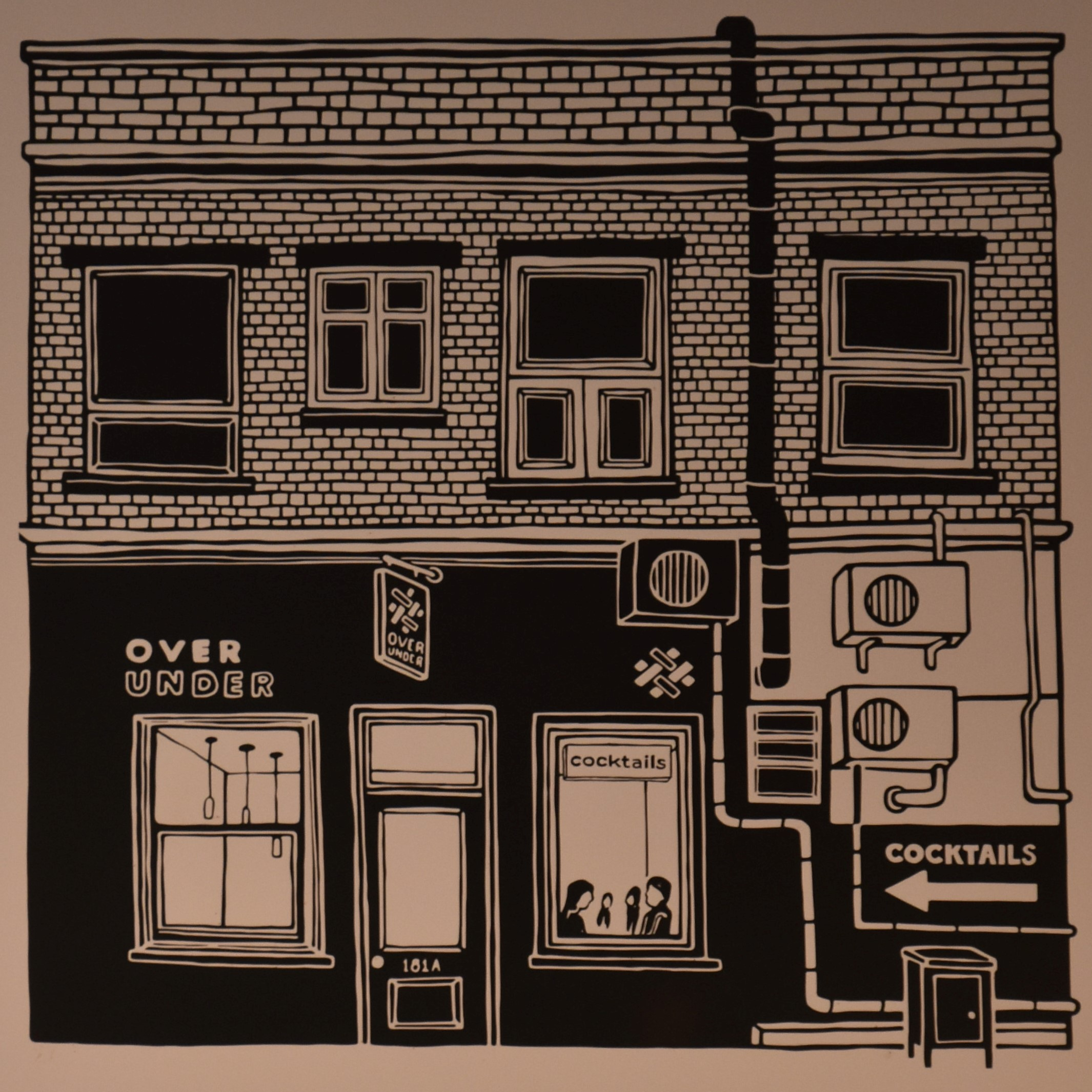 A black and white line drawing of Over Under Coffee, as seen from the street, which is on the menu boards hanging behind the counter.