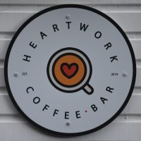 The Heartwork Coffee Bar logo from the side of the horsebox which acts as the coffee bar.