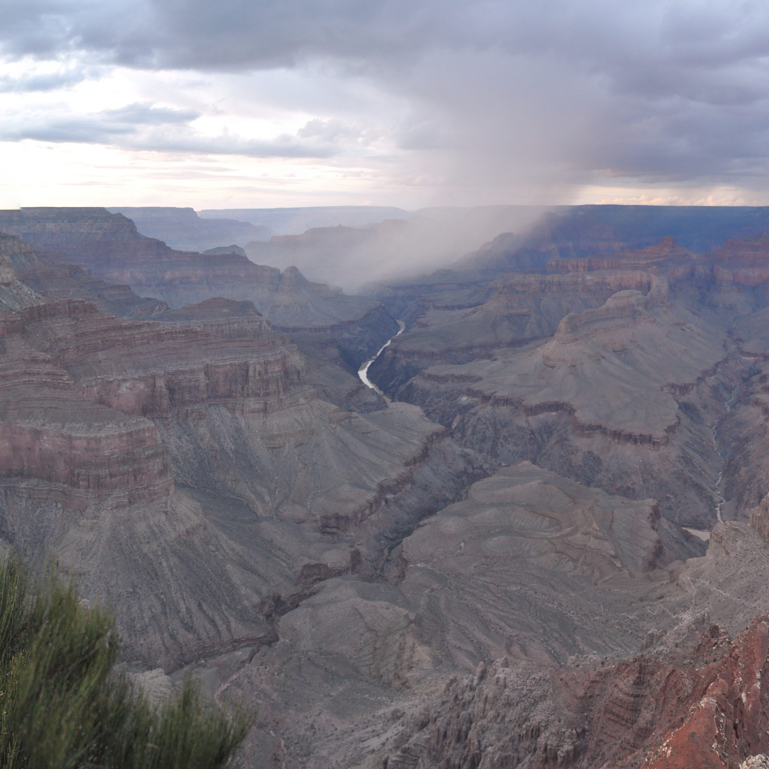 Rain over the Grand Canyon, seen looking north from Mohave Point on the Rim Trail, with the Colorado River at the bottom of the canyon.