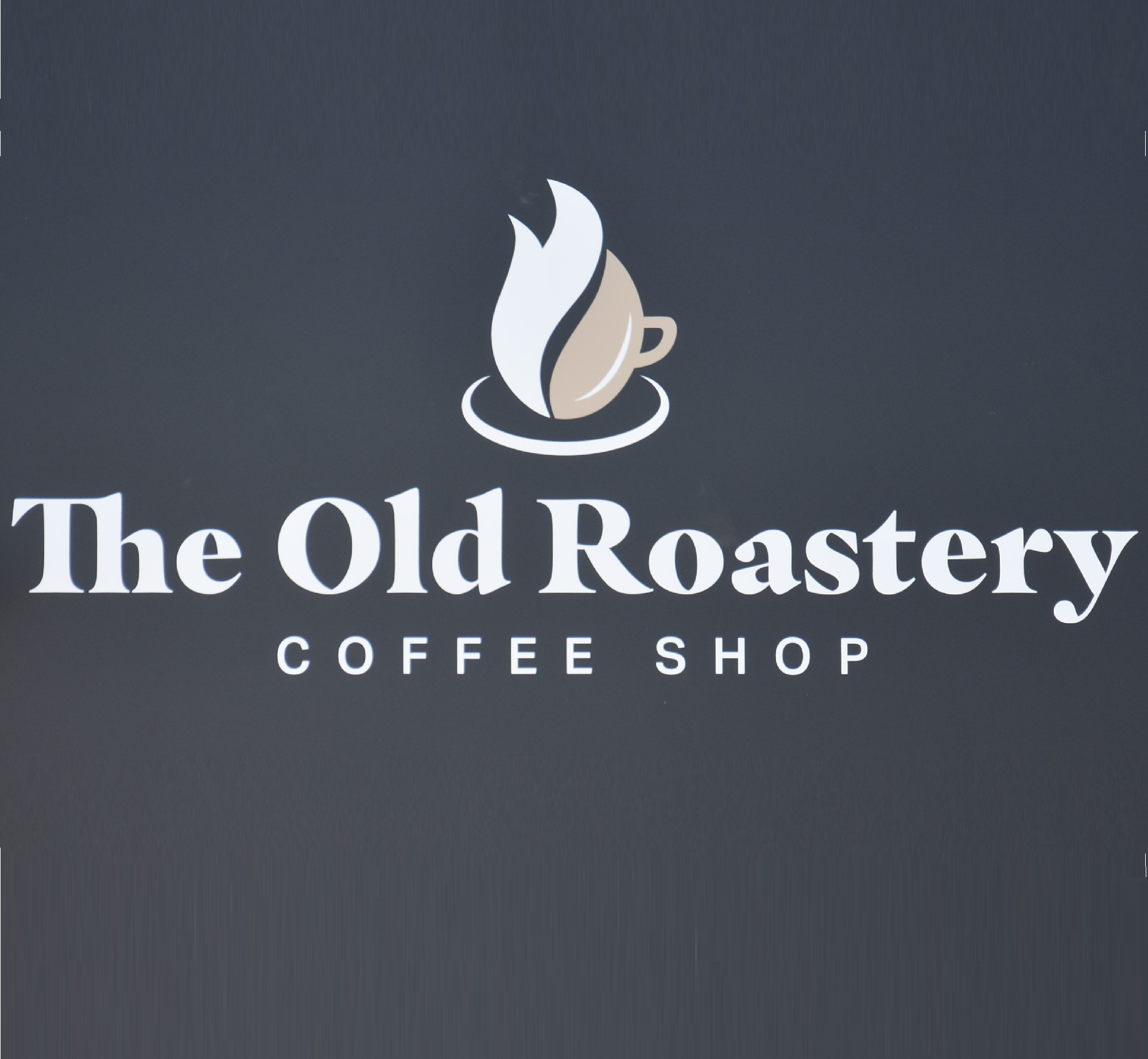 The name over the door: The Old Roastery Coffee Shop, occupying Redber Coffee Roasters' old roastery.