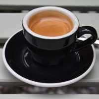 A classic espresso in a classic black cup, served at The Coffee Traveller in Chiswick.