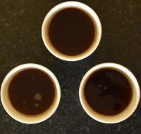 Three bowls of coffee, seen from above, two roasted by Quarter Horse and one by Hundred House. But which is the odd one out?