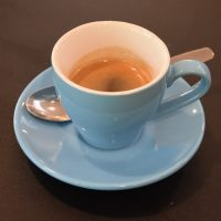 An espresso in a classic blue cup at Open Grounds Cafe