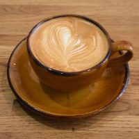 A gorgeous flat white in an equally gorgeous, bowl-shaped earthenware cup, served at Surbeanton in Surbiton.
