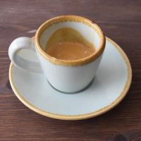 A classic espresso in a handmade cup from Surrey Ceramics, served at The Hideaway in Guildford.