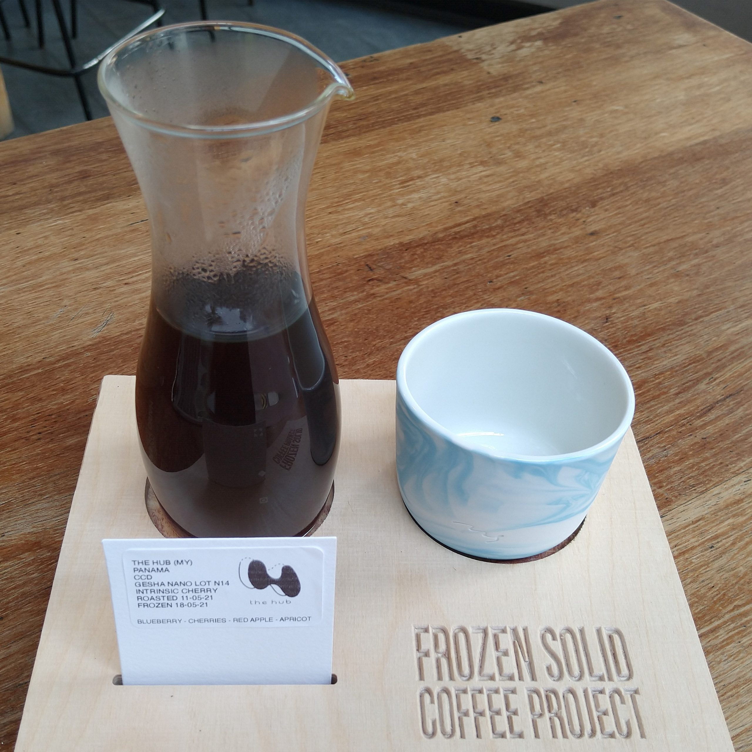 My coffee, the Nano Lot N14, a Gesha grown by Creativa Coffee District in Panama, roasted by The Hub in Malaysia and served in a carafe, with a lovely ceramic cup on the side, all presented on a wooden tray, part of the Frozen Solid Coffee Project at Tilt in Birmingham.