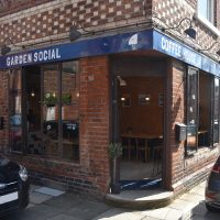 The front of Garden Social Coffee House on the corner of Catherine and Charlotte Streets, the open door showing no favouritism to either!