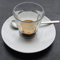 An espresso, made with Workshop's Snap single-origin espresso, served in a glass at Gray in Leytonstone.