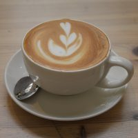 A classic decaf flat white served in a classic white cup at Medicine New Street in Birmingham