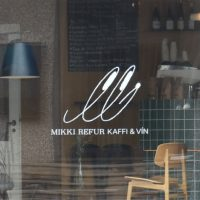Detail from the window of Mikki Refur: Kaffi & Vin.