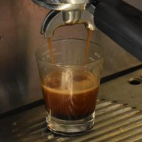 An espresso extracting into a glass from a Rancilio Silvia espresso machine at Sarah's Leytonstone.