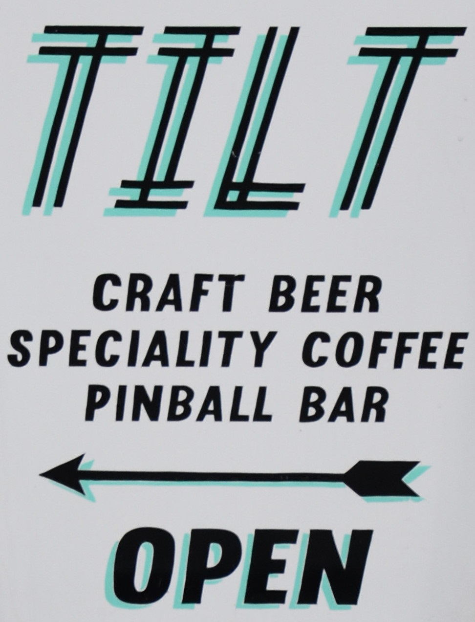 Details of the new (to me, at least) A-board from outside Tilt in Birmingham, promising craft beer, speciality coffee and pinball.