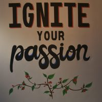 Ignite your passion: detail from the wall in the back corner of Java Roastery in Moseley.