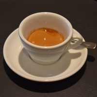 A single-origin washed Ethiopian espresso in a classic white cup, served at Kaffi Ó-le in Reykjavik.