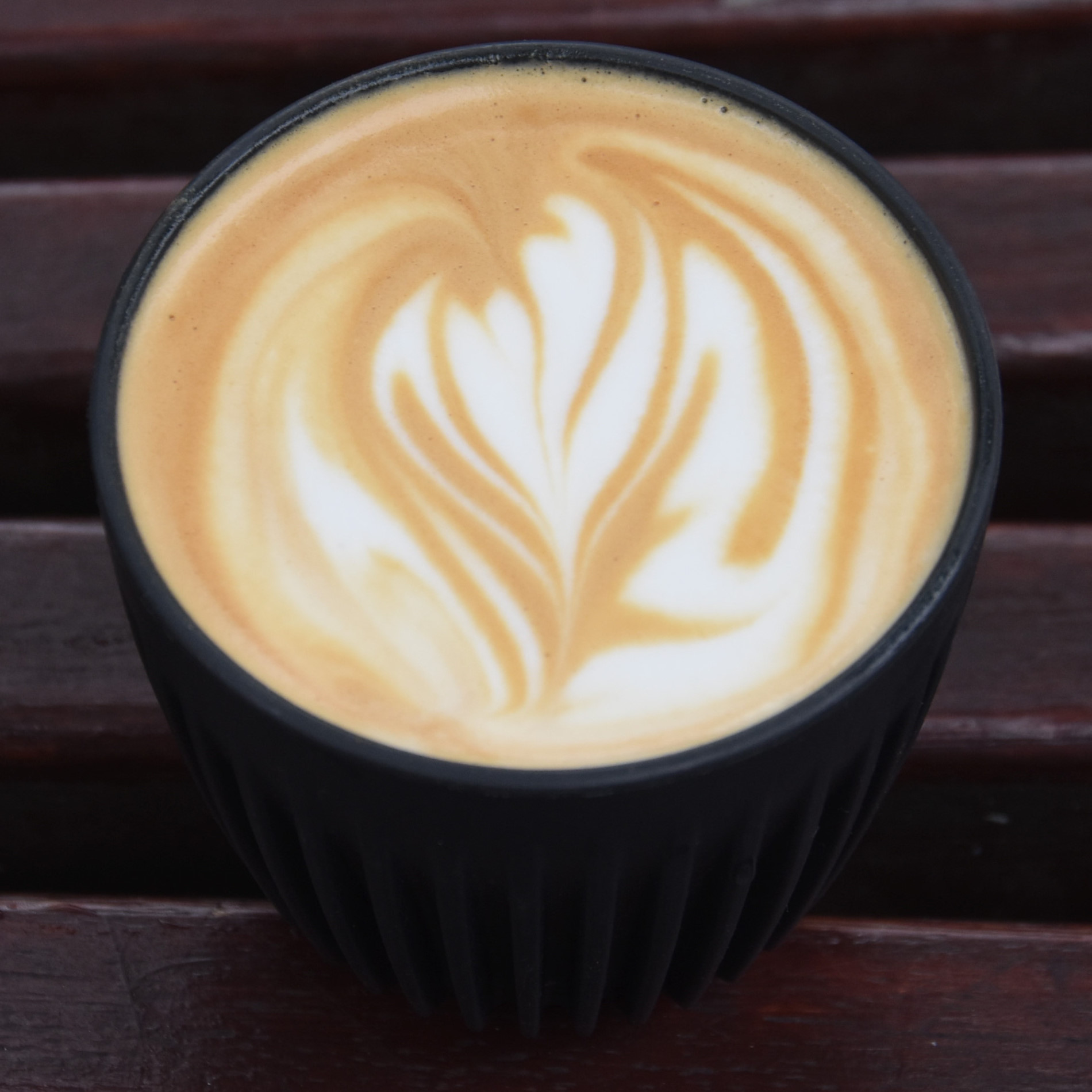 A lovely flat white with an abstract latte art pattern in it, made with the Over Under house blend and served in my HuskeeCup at Over Under Coffee, Wandsworth Town.