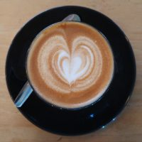 The latte art in my flat white at Bank Street Social in Wrexham.