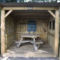 One of the cabins, known as Cwch Gwenyn (The Hive), in the garden at the back of Caffi Caban.
