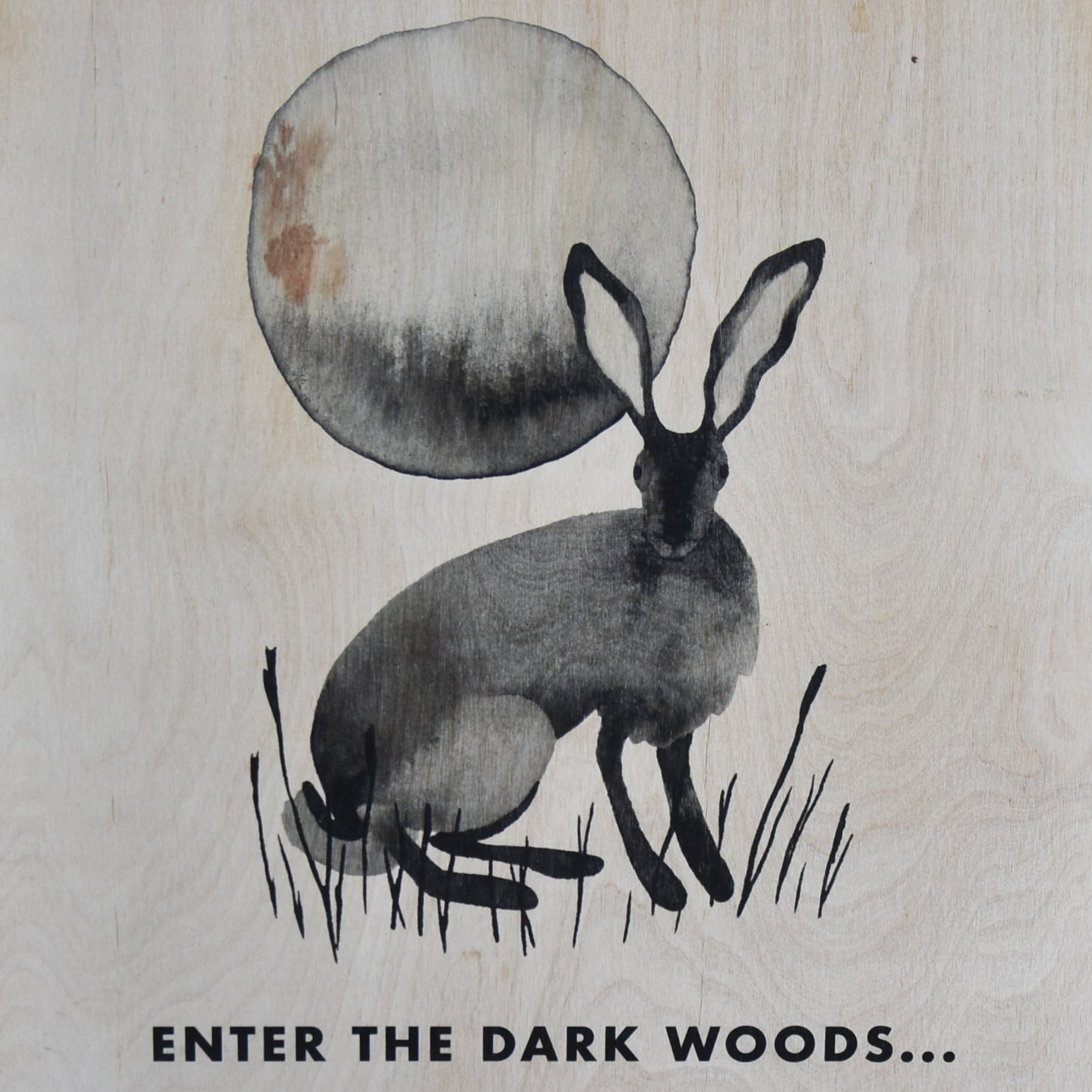 """Detail from the A-board outside Marmalade in Holywell, a drawing of a hare in front of the mooon, with the caption """"enter the Dark Woods..."""""""