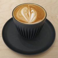 A flat white in a HuskeeCup, served at The Table in Walsall.