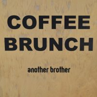 """The A-board outside Another Brother in Wandsworth, proclaiming: """"Coffee 
