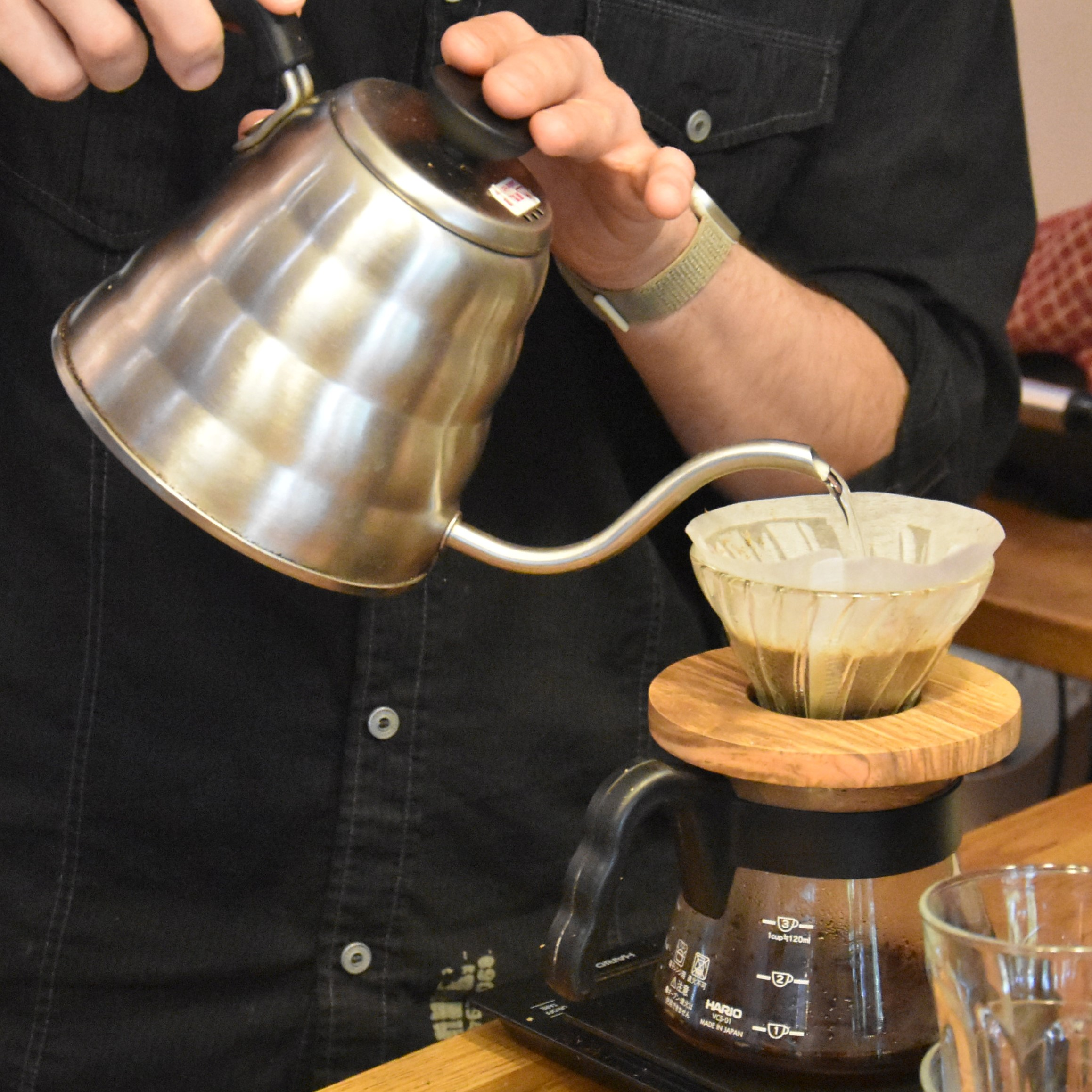 A V60 pour-over being made using a gooseneck kettle at MyCloud Coffee.