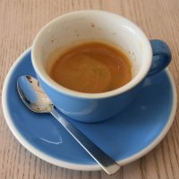 A double shot of espresso in a classic, oversized blue cup, served at Saucer & Cup.
