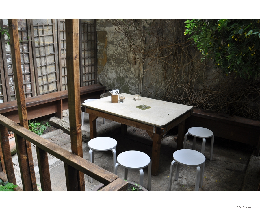There's another table at the left-hand end of the garden.