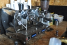 ... with the shiny, two-group espresso machine on the counter below.