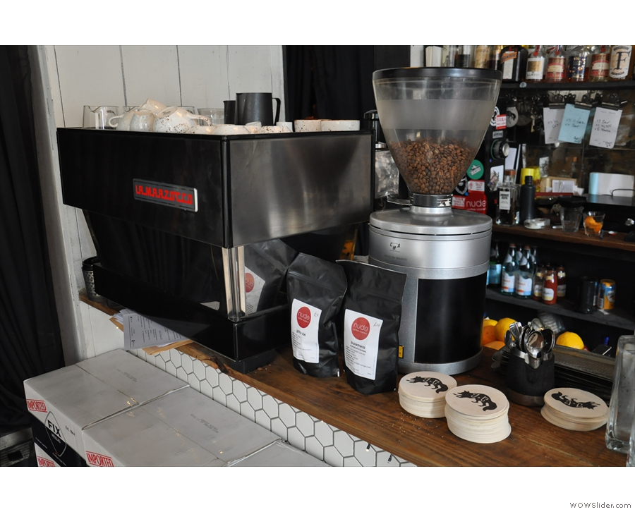 The espresso machinie is at the far end of the counter...