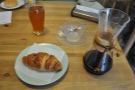I paired my coffee with a chocolate croissant. The beer is not mine. Nor is the doughnut.