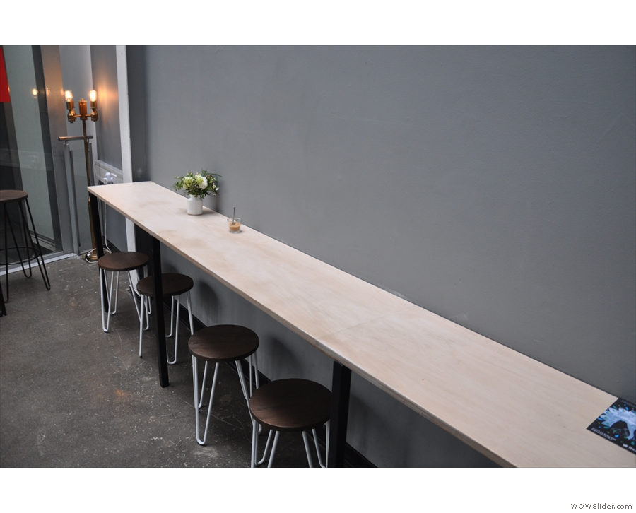 The other seating is in the form of this bar against the left-hand wall, opposite the windows.
