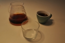 My coffee in the cup, with a glass of water in the foreground.