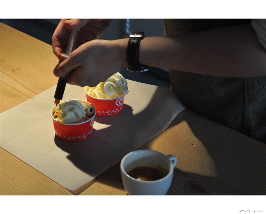 ... taking care to ensure that it is evenly distributed around the ice-cream.