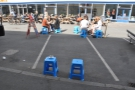 ... just help yourself to a blue, plastic stool and go sit in the sun!
