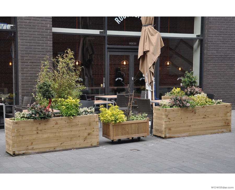 There's a large outdoor seating area on the pedestrianised street, fenced off by planters.