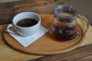 It was served properly, in a carafe, with a cup on the side, presented on a wooden tray.