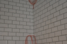 The white-tiled walls in Root have been illustrated with line-drawings of coffee plants...