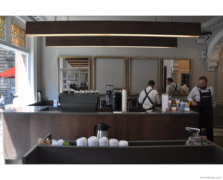The counter takes up the left-hand side, the espresso machine front and centre.