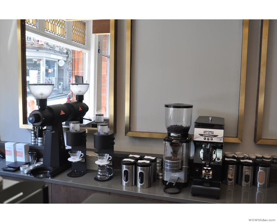 The grinders for the single-origin espresso and decaf are at the back, along with the filter.