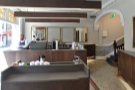 The view across the central island to the counter on the far side. Lots of mirrors in here!