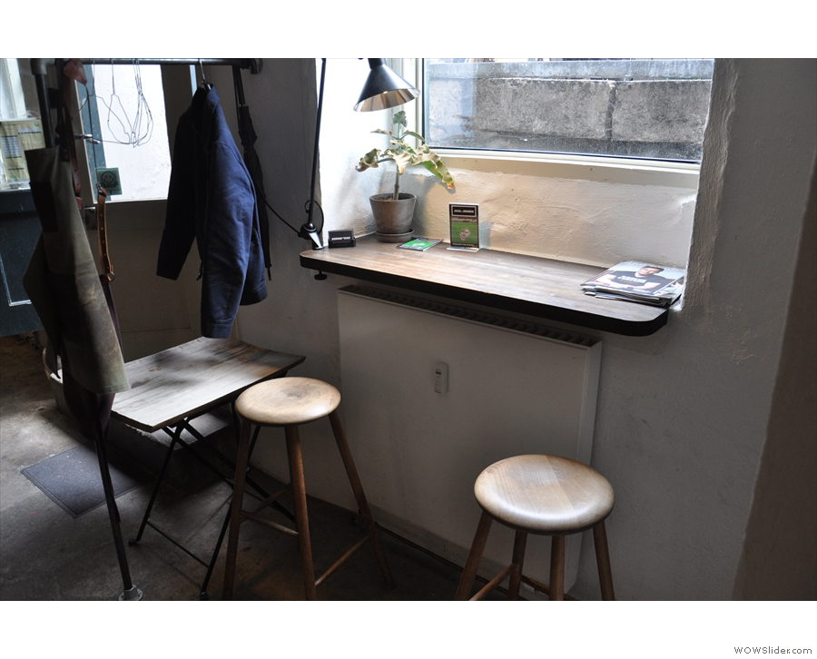 There's not much other seating in the main room, just these two stools by the window...