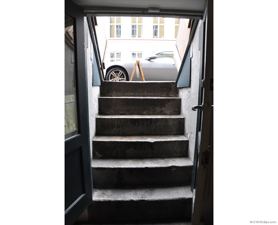 The steps leading down to Copenhagen Coffee Lab, as seen from the inside.