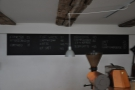 The concise menu is chalked up on a pair of blackboards on the wall behind the counter...